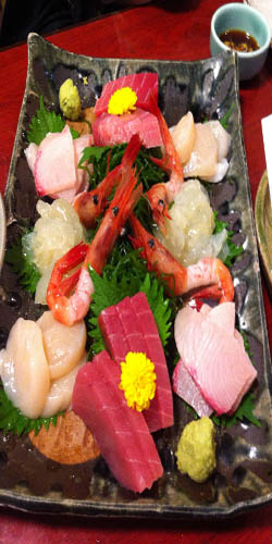 A plate vith various types of sashimi.