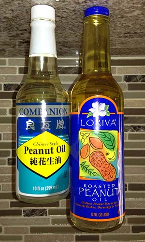 Bottles of roasted and unroasted peanut oil.